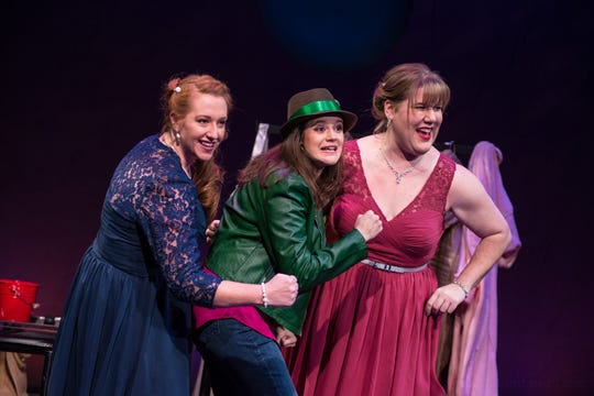 """Marcee Doherty-Elst (left), Susie Duecker and Kelly Doherty sing in Next Act Theatre's recent production of """"The Twelve Dates of Christmas."""""""