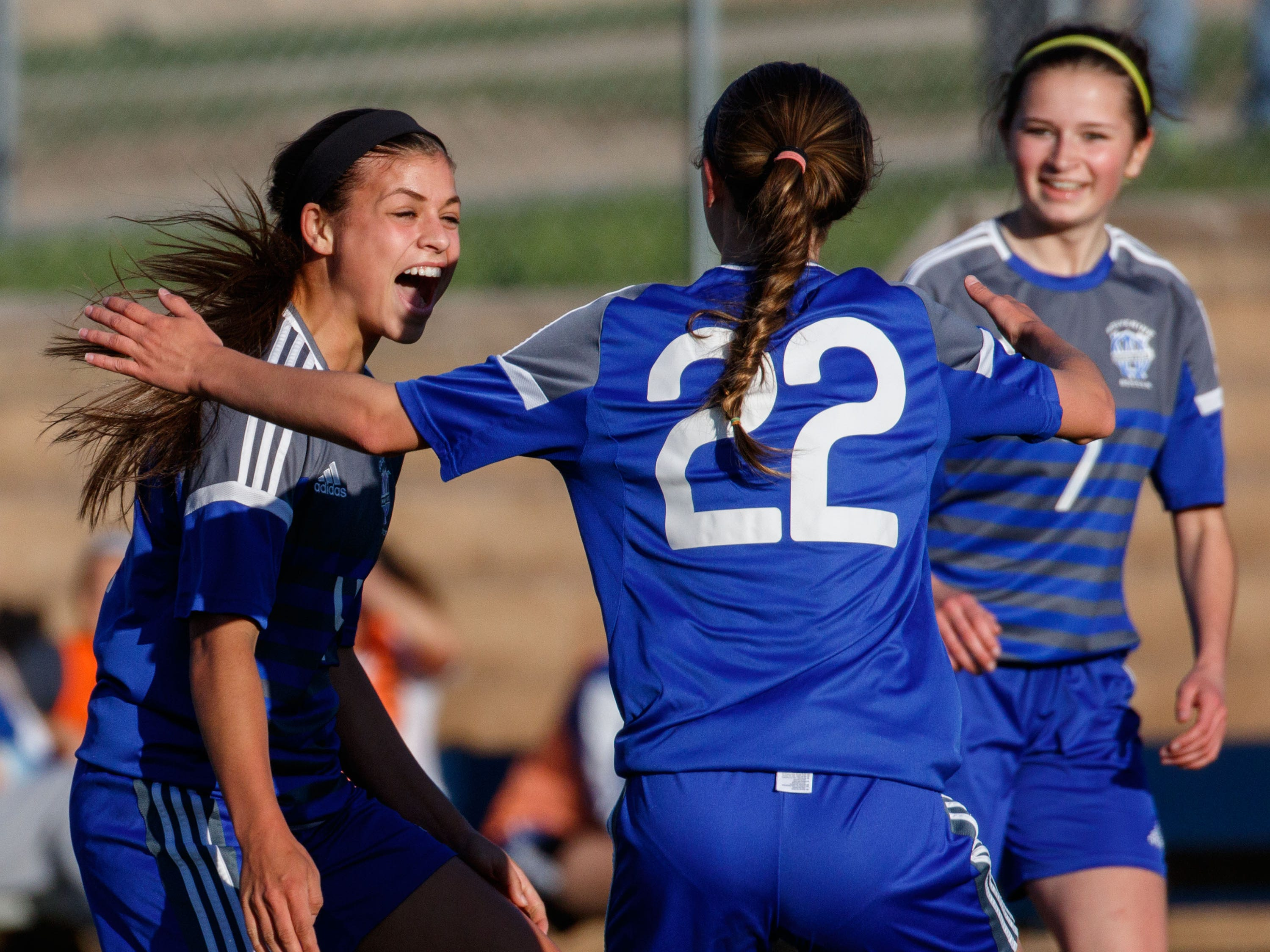 Waukesha West senior Dani Rhodes (left) celebrates her first of three goals on the night with teammates Josie Zindler (22) and Taylor Wiegert (7) during the match against Catholic Memorial at Carroll College on Tuesday, May 17, 2016.