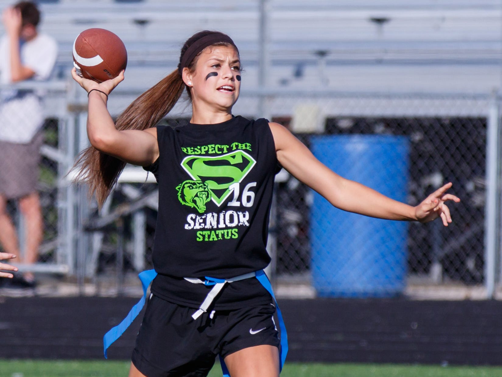 Waukesha West senior Dani Rhodes gets set to throw a pass during the powderpuff football game against the juniors on Sept. 23, 2015, at the high school. The seniors defeated the juniors 22-6 in the championship game.