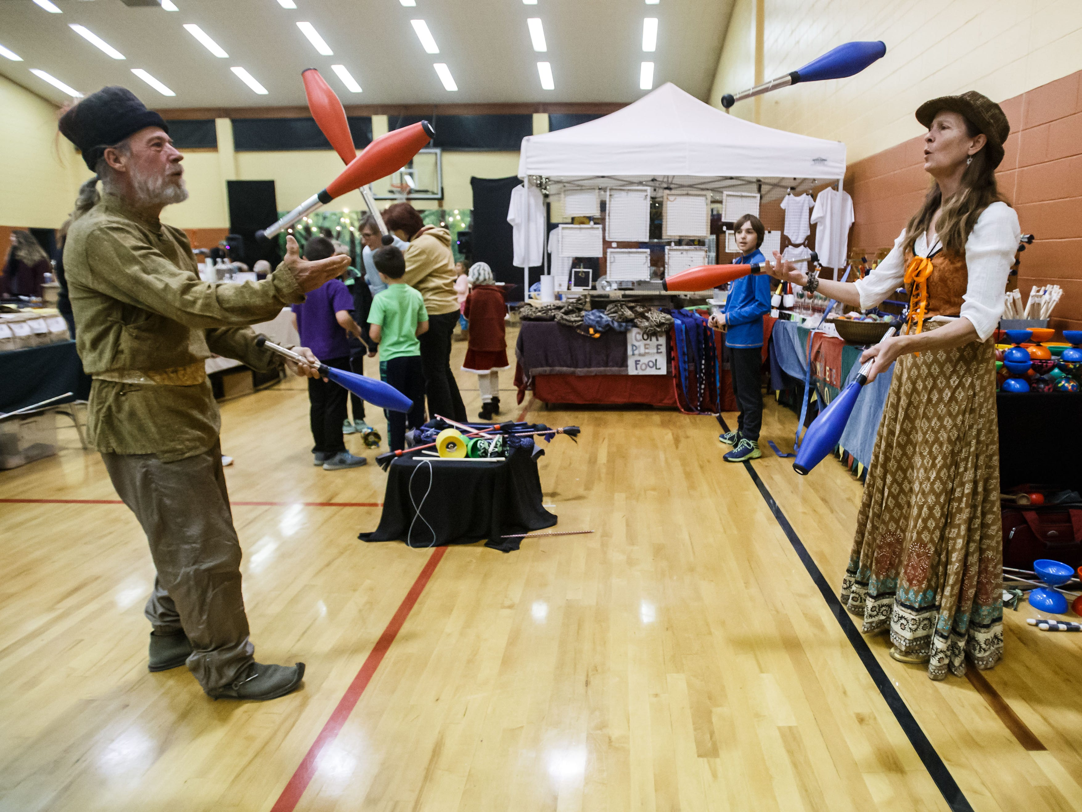 Brian and Rebecca Hendrickson of Madison perform a juggling routine during the 31st annual Yuletide Faire at Prairie Hill Waldorf School in Pewaukee on Friday, Nov. 16, 2018. The magical medieval marketplace features live music, artisans, children's activities, costumed characters, food, refreshments, sweets and more.