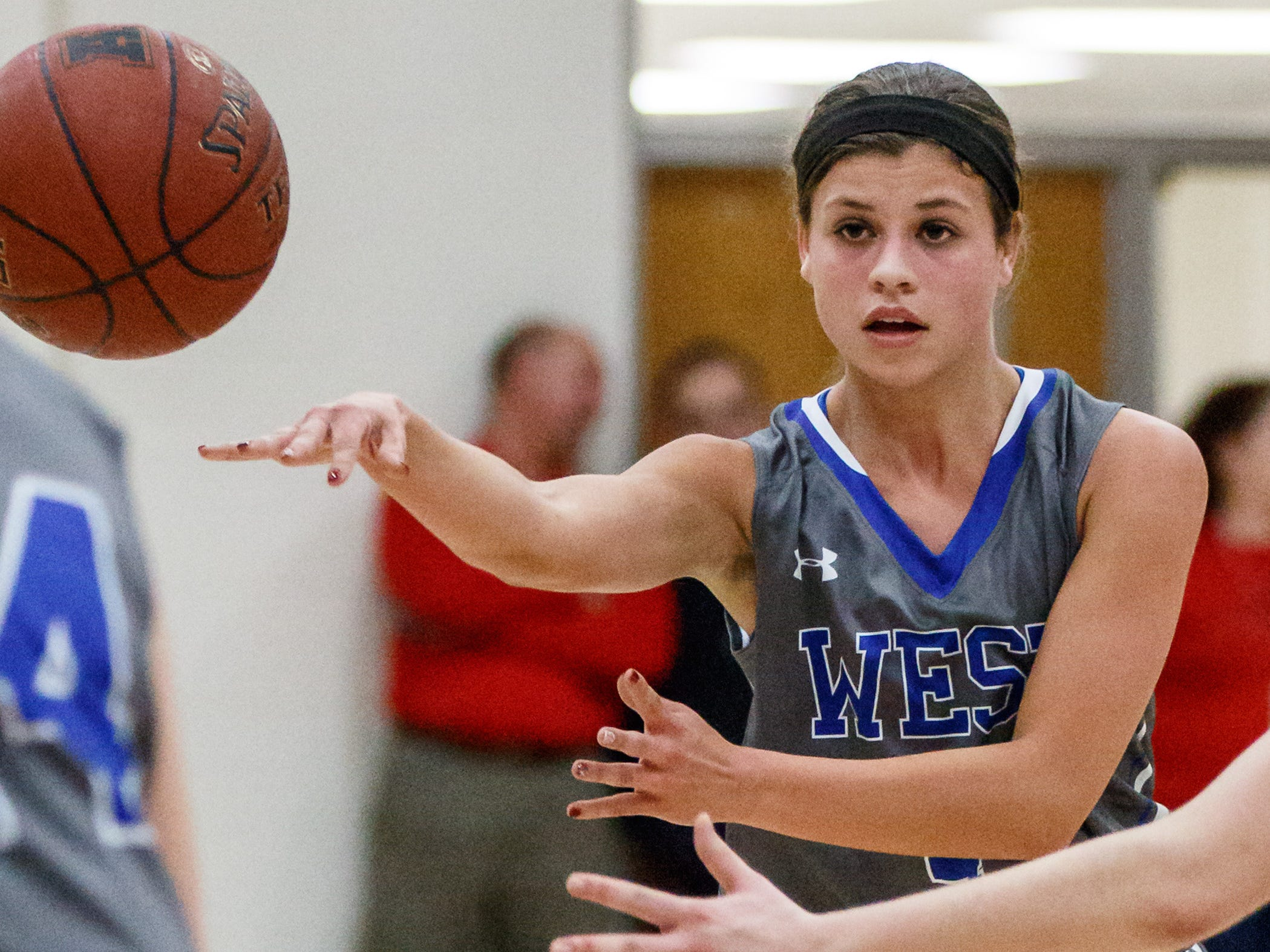 Waukesha West junior Dani Rhodes fires off a pass during a game against Arrowhead on Feb. 6, 2015.
