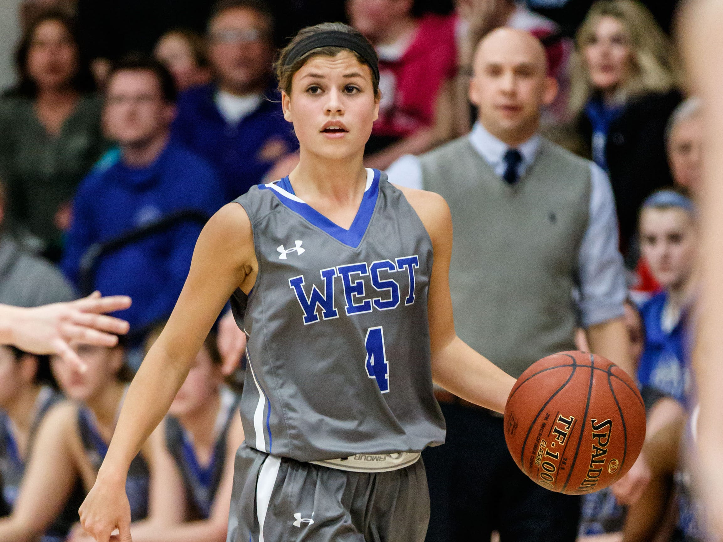 Waukesha West junior Dani Rhodes brings the ball  up the court during the game at Arrowhead on Feb. 6, 2015.
