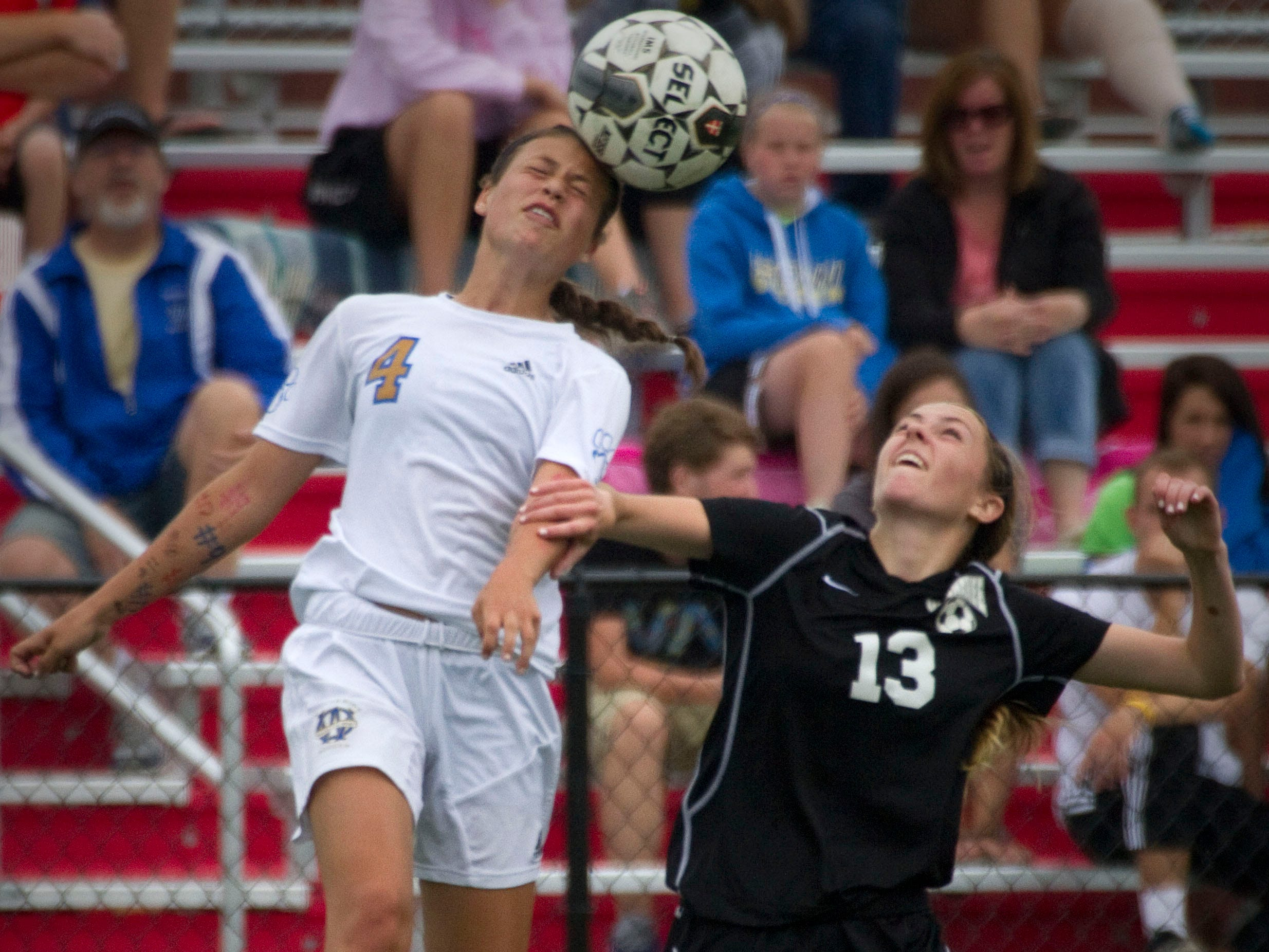 Waukesha West's Dani Rhodes (4) heads the ball over Waumakee's Erin Freeman during a state title match in 2014. West finished as the state runner-up.