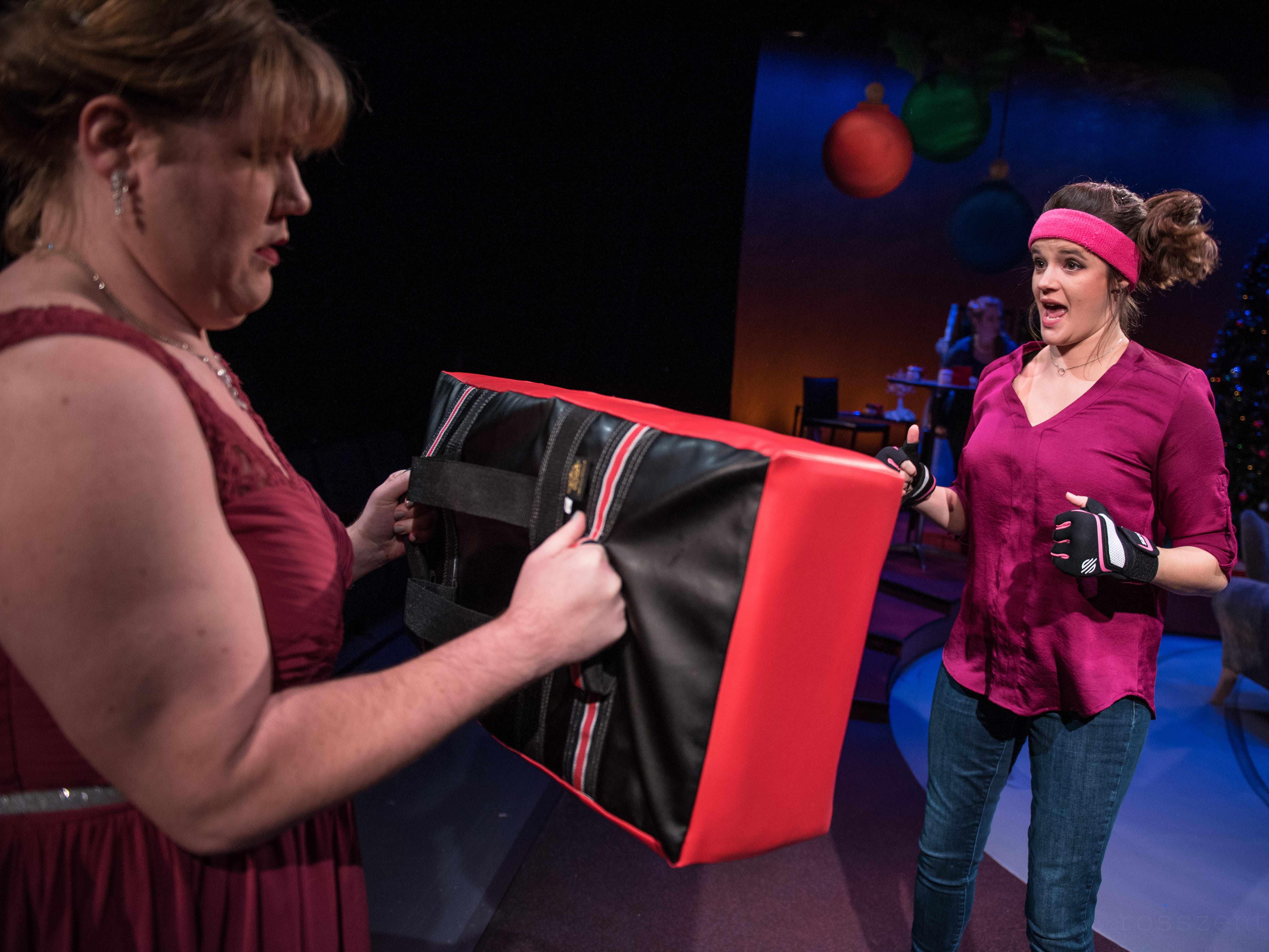 "With Kelly Doherty's help, Susie Duecker works out her frustration in ""The Twelve Dates of Christmas"" at Next Act Theatre."