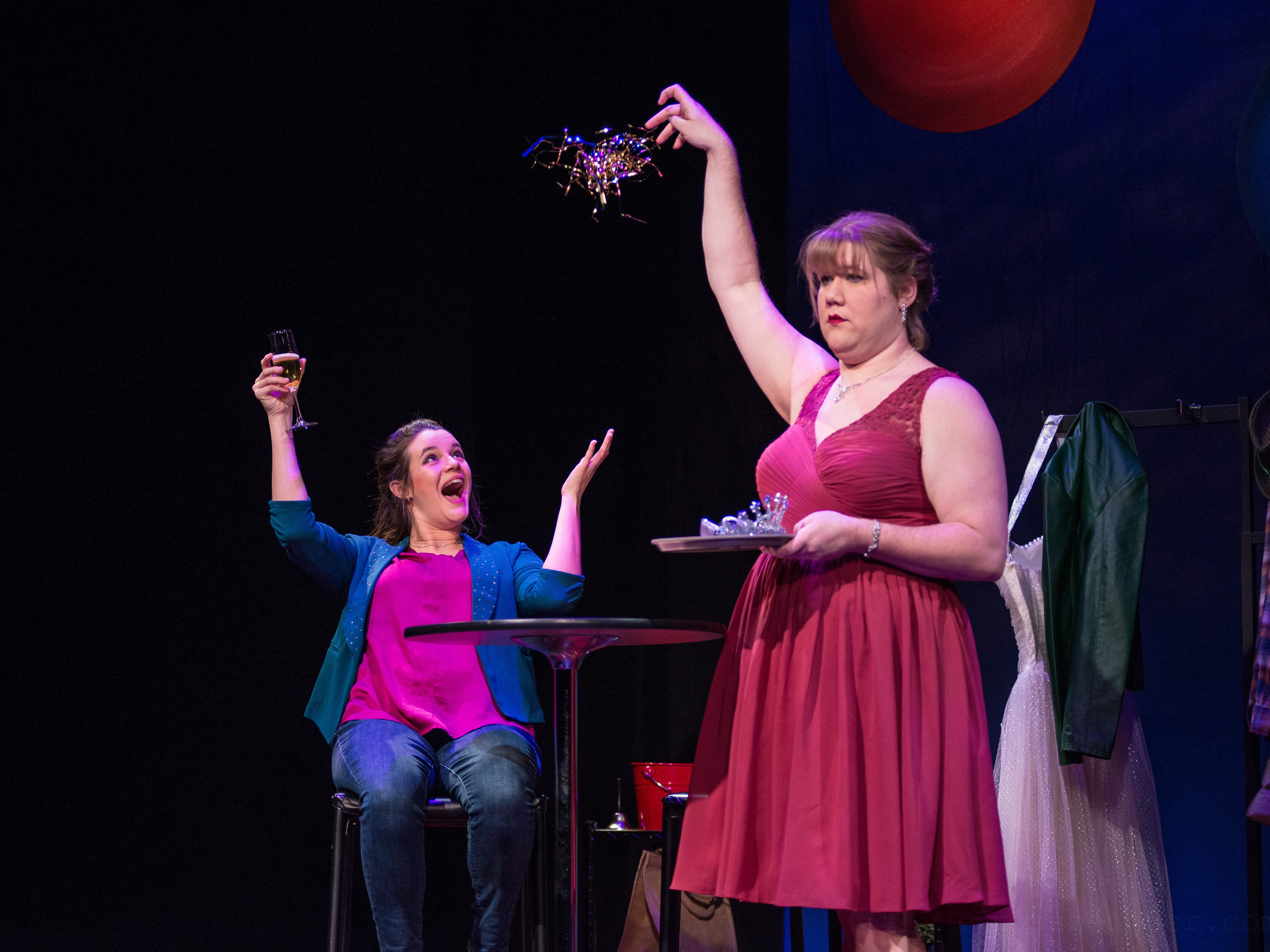 "Susie Duecker celebrates as Kelly Doherty delivers confetti in ""The Twelve Dates of Christmas"" at Next Act Theatre."