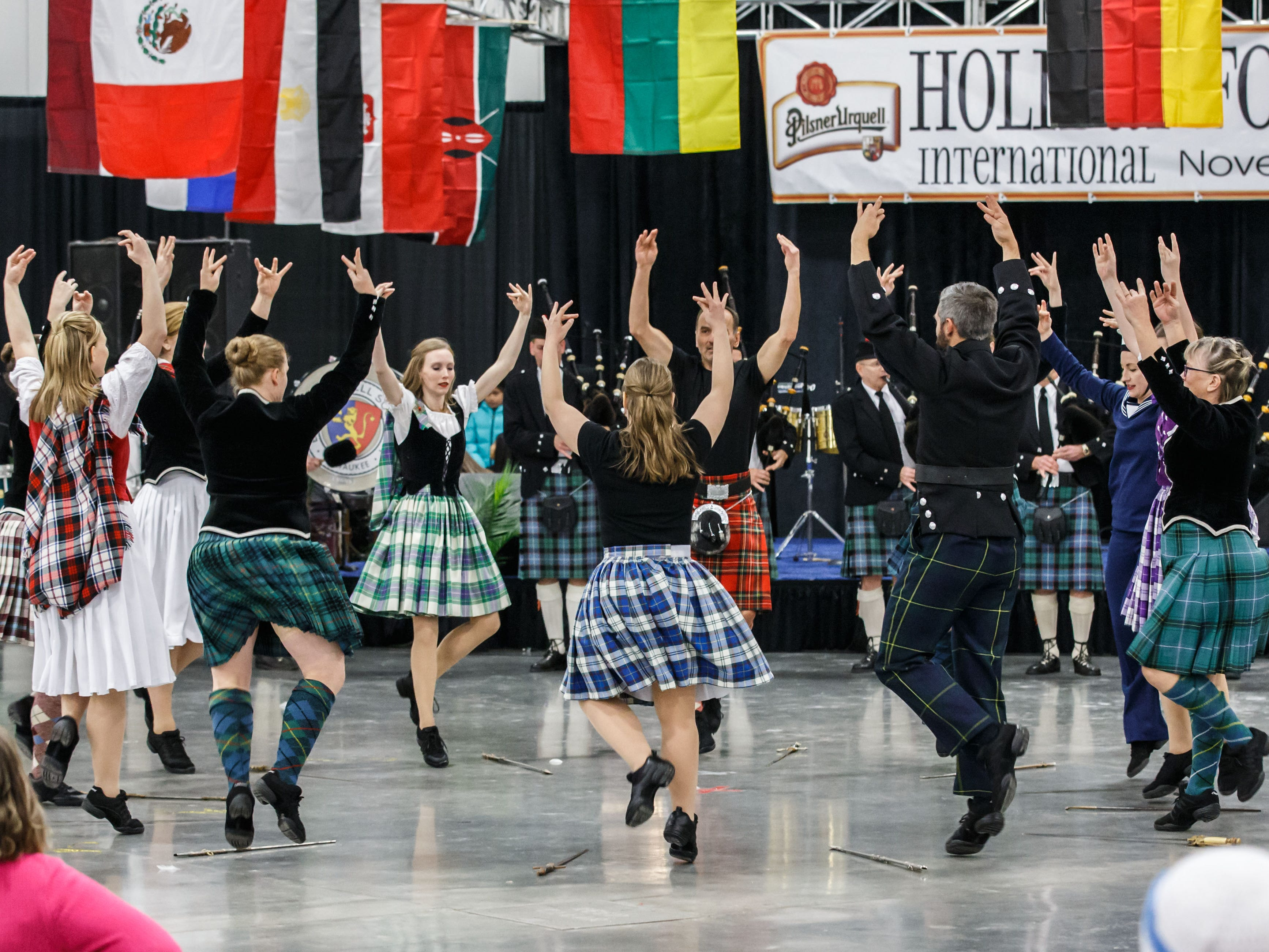 Scottish dancers perform a sword dance during the 75th annual Holiday Folk Fair International at State Fair Park on Saturday, Nov. 17, 2018. The festival celebrates southeastern Wisconsin's multicultural heritage through music, food, dance and art.