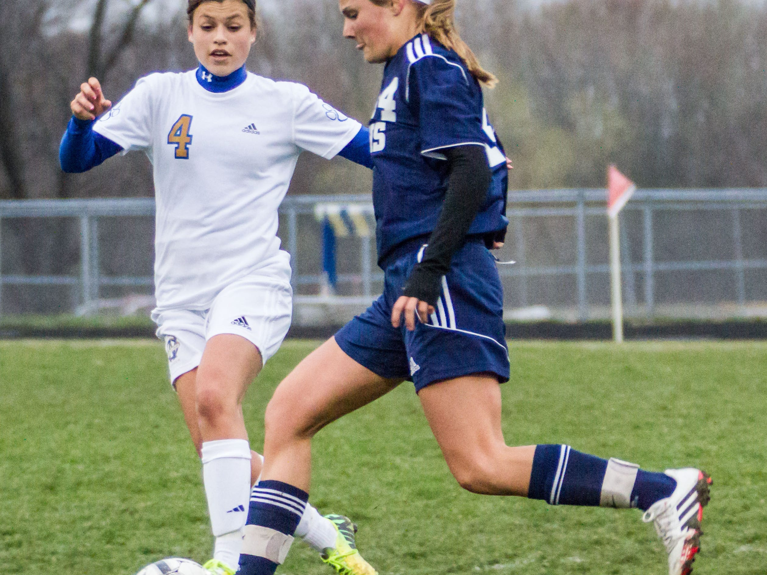 Waukesha West sophomore Dani Rhodes (4) and Kettle Moraine's Lauren Hotchkiss (14) battle for possession at West on Wednesday, April 30, 2014.