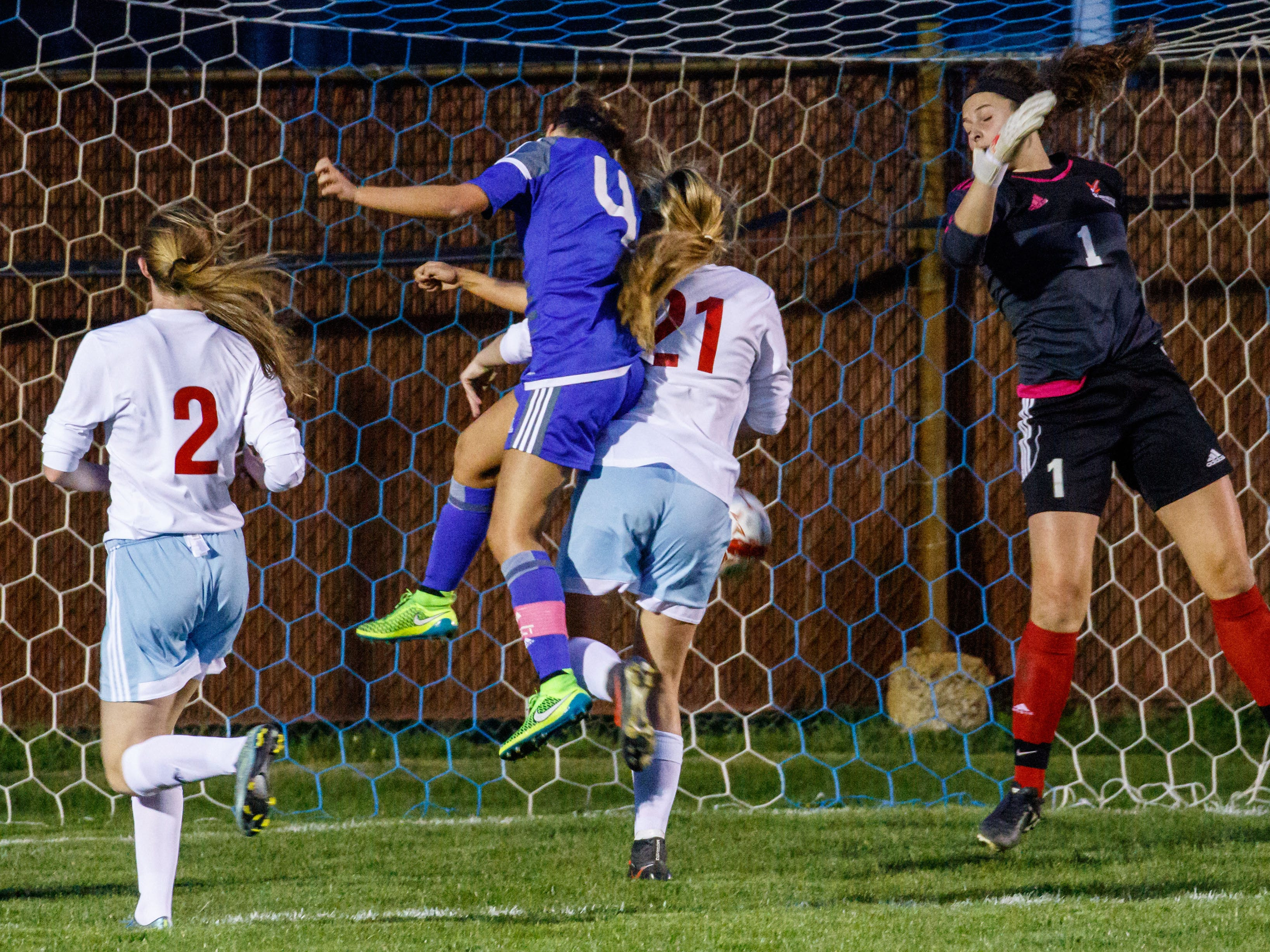 Waukesha West senior Dani Rhodes (4) scores with a header late in the match at Arrowhead on Tuesday, May 3, 2016 to give Waukesha a 1-0 victory.