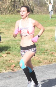 Alexandra Cassar of Omaha, Neb., nears the finish line of the White River Marathon on Saturday.