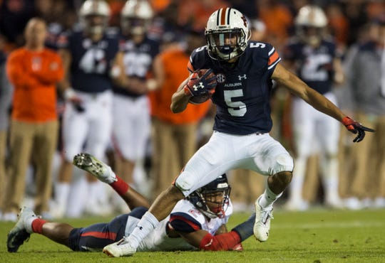 Auburn wide receiver Anthony Schwartz (5) runs the ball after making a catch against Liberty at Jordan-Hare Stadium in Auburn, Ala., on Saturday, Nov.. 17, 2018. Auburn defeated Liberty 53-0.