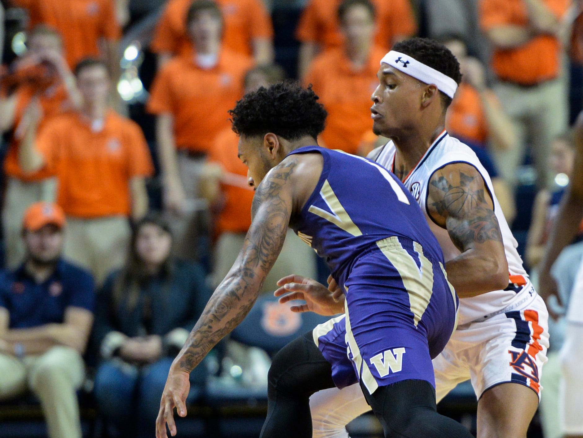 Nov 9, 2018; Auburn, AL, USA; Auburn Tigers guard Bryce Brown (2) fouls Washington Huskies guard David Crisp (1) at Auburn Arena. Mandatory Credit: Julie Bennett-USA TODAY Sports