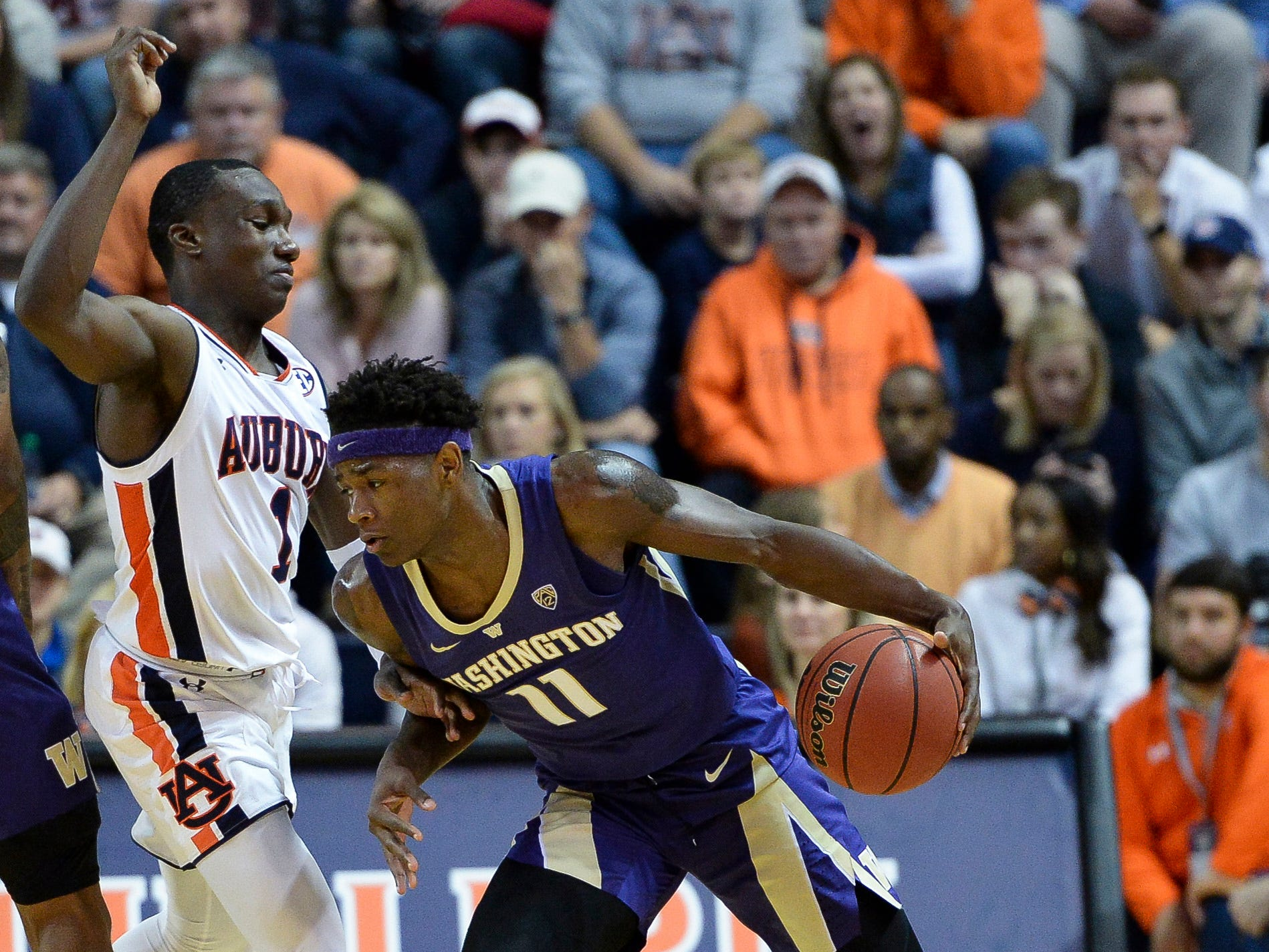 Nov 9, 2018; Auburn, AL, USA; Washington Huskies forward Nahziah Carter (11) dribbles the ball past Auburn Tigers guard Jared Harper (1) at Auburn Arena. Mandatory Credit: Julie Bennett-USA TODAY Sports