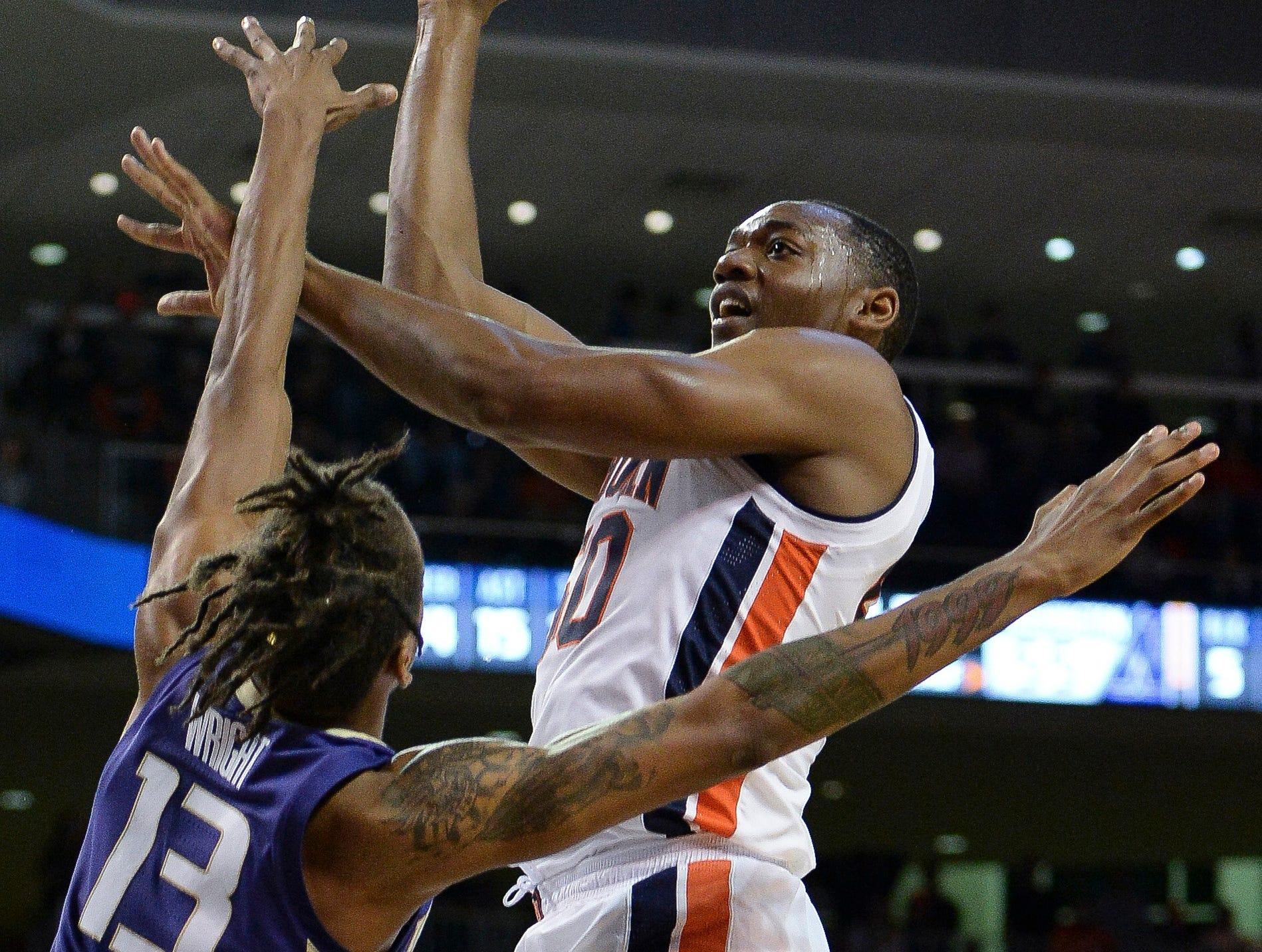 Nov 9, 2018; Auburn, AL, USA; Auburn Tigers center Austin Wiley (50) shoots the ball as Washington Huskies forward Hameir Wright (13) defends at Auburn Arena. Mandatory Credit: Julie Bennett-USA TODAY Sports