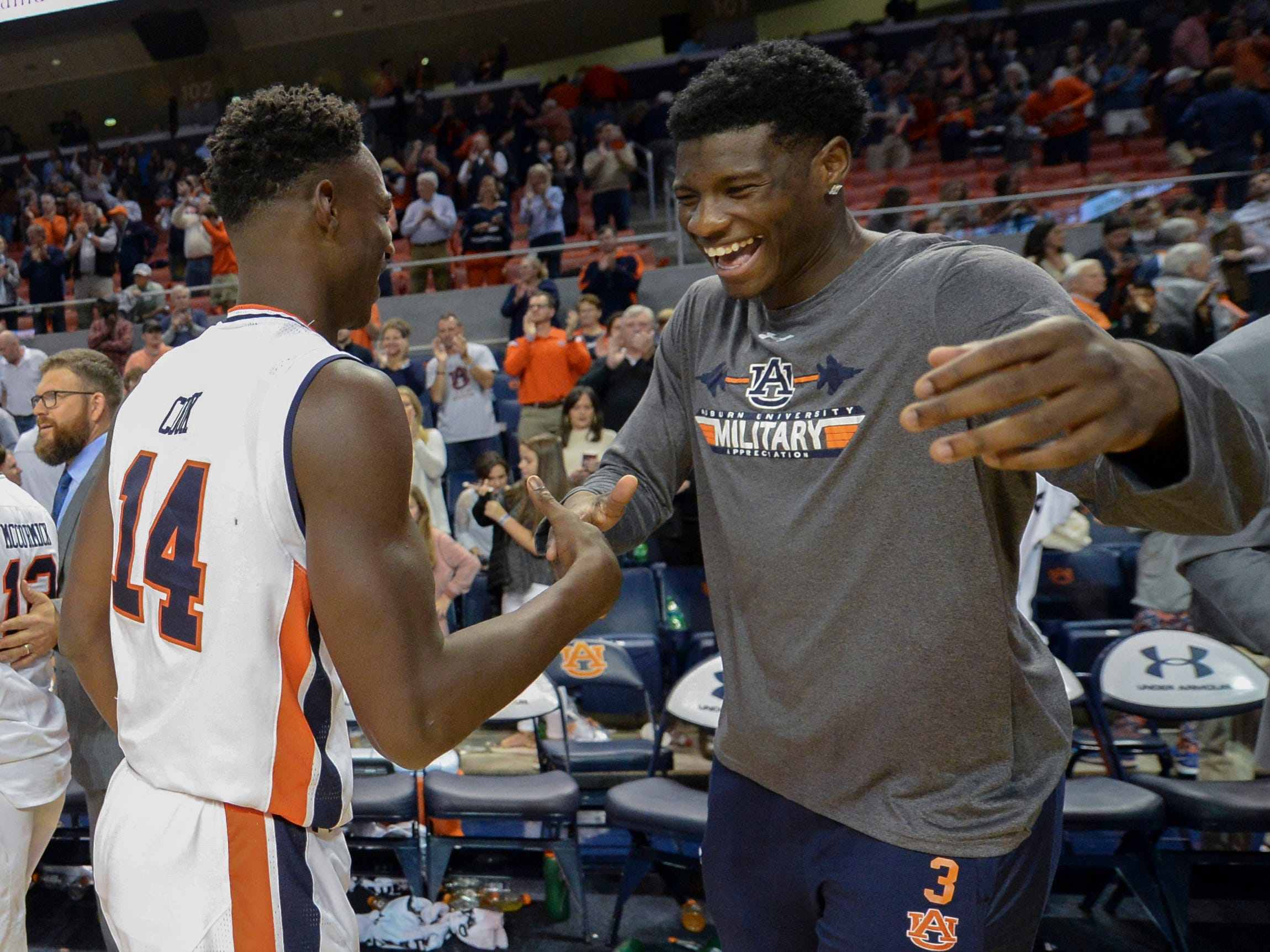 Auburn forward Danjel Purifoy (right) celebrates the 88-66 win over Washington at Auburn Arena.