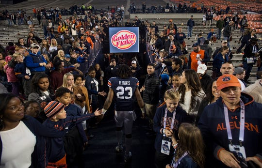 Auburn wide receiver Ryan Davis (23) walks off the field after the game at Jordan-Hare Stadium in Auburn, Ala., on Saturday, Nov.. 17, 2018. Auburn defeated Liberty 53-0.