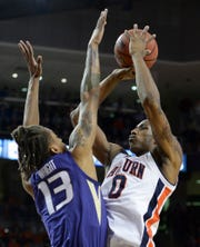 Auburn forward Horace Spencer (0) shoots the ball over Washington forward Hameir Wright (13) at Auburn Arena on Nov. 9, 2018.