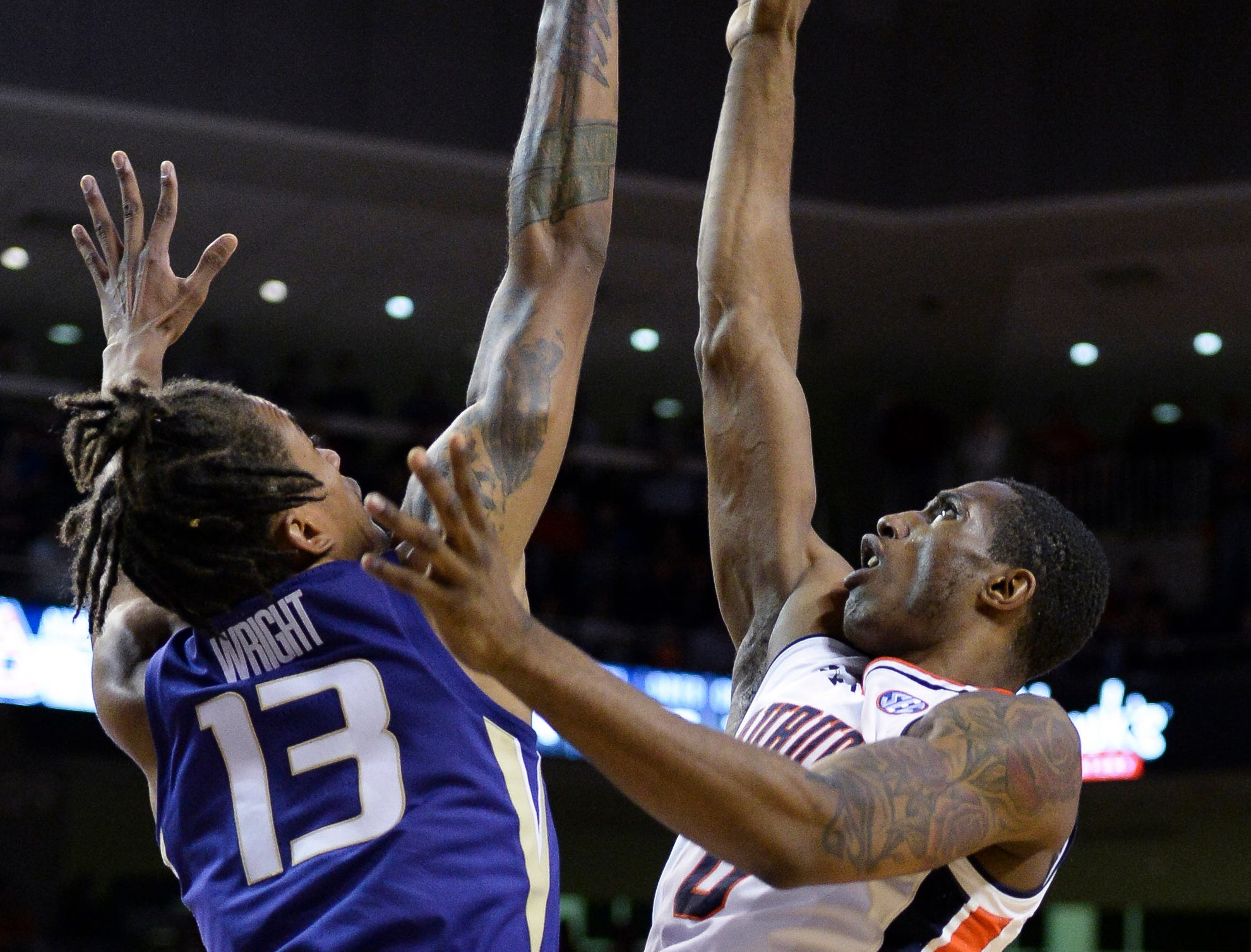 Nov 9, 2018; Auburn, AL, USA; Washington Huskies forward Hameir Wright (13) blocks a shot by Auburn Tigers forward Horace Spencer (0) at Auburn Arena. Mandatory Credit: Julie Bennett-USA TODAY Sports