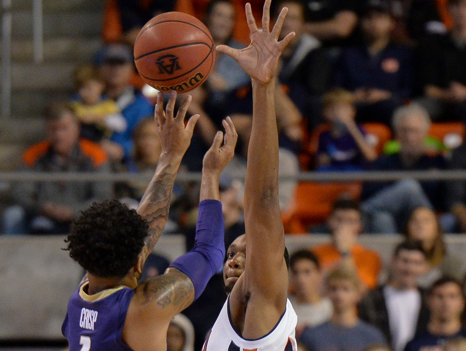 Nov 9, 2018; Auburn, AL, USA; Auburn Tigers center Austin Wiley (50) defends a shot by Washington Huskies guard David Crisp (1) at Auburn Arena. Mandatory Credit: Julie Bennett-USA TODAY Sports