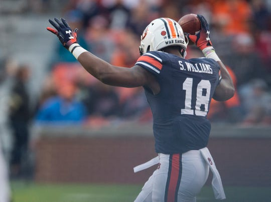 Auburn wide receiver Seth Williams (18) catches the ball on the sideline at Jordan-Hare Stadium in Auburn, Ala., on Saturday, Nov.. 17, 2018. Auburn defeated Liberty 53-0.