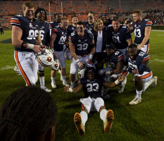Auburn senior players pose for a picture with coach Gus Malzahn's wife, Kristi, on senior day after the game at Jordan-Hare Stadium in Auburn, Ala., on Saturday, Nov. 17, 2018. Auburn defeated Liberty 53-0.