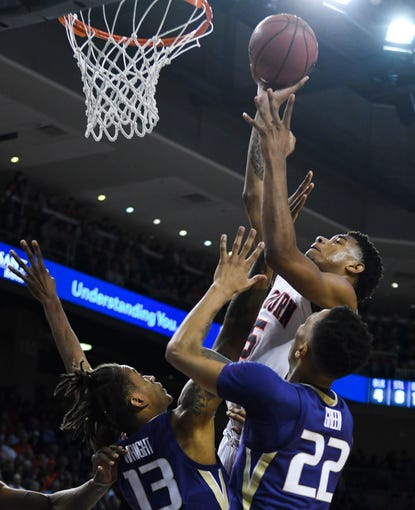 Nov 9, 2018; Auburn, AL, USA; Auburn Tigers forward Chuma Okeke (5) shoots the ball over Washington Huskies forward Hameir Wright (13) and Huskies forward Dominic Green (22) at Auburn Arena. Mandatory Credit: Julie Bennett-USA TODAY Sports