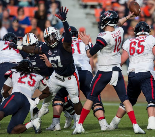 Auburn linebacker Deshaun Davis (57) attempts to knock down Liberty quarterback Stephen Calvert (12) pass at Jordan-Hare Stadium in Auburn, Ala., on Saturday, Nov.. 17, 2018. Auburn defeated Liberty 53-0.
