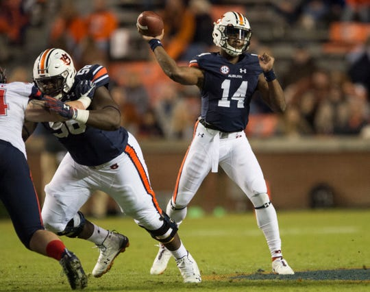 Auburn quarterback Malik Willis (14) throws the ball against Liberty at Jordan-Hare Stadium in Auburn, Ala., on Saturday, Nov.. 17, 2018. Auburn defeated Liberty 53-0.