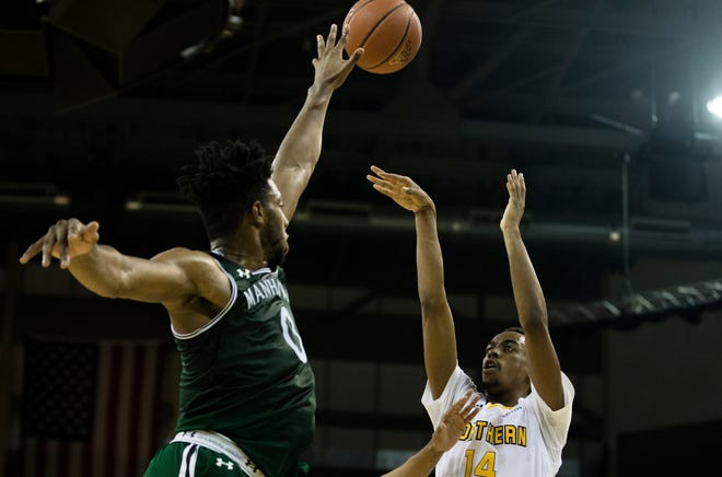 Northern Kentucky Norse guard Jalen Tate (14) shoots over Manhattan Jaspers forward Warren Williams (0) during the NCAA men's basketball game between Northern Kentucky Norse and Manhattan Jaspers in the Northern Kentucky Basketball Classic tournament on Saturday, Nov. 17, 2018, at NKU's BB&T Arena in Highland Heights, Ky.