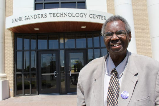 State Sen. Hank Sanders stands in front of a technology building named for him on the campus of Wallace Community College Selma.