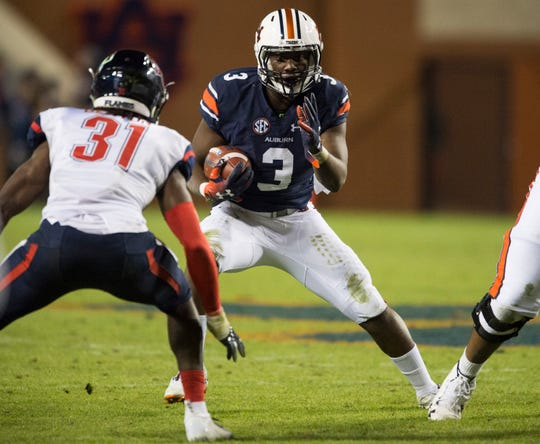 Auburn running back Asa Martin (3) runs the ball against Liberty at Jordan-Hare Stadium in Auburn, Ala., on Saturday, Nov.. 17, 2018. Auburn defeated Liberty 53-0.