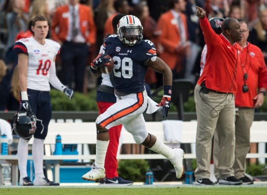 Auburn running back JaTarvious Whitlow (28) runs the ball down the sideline at Jordan-Hare Stadium in Auburn, Ala., on Saturday, Nov.. 17, 2018. Liberty 53-0.