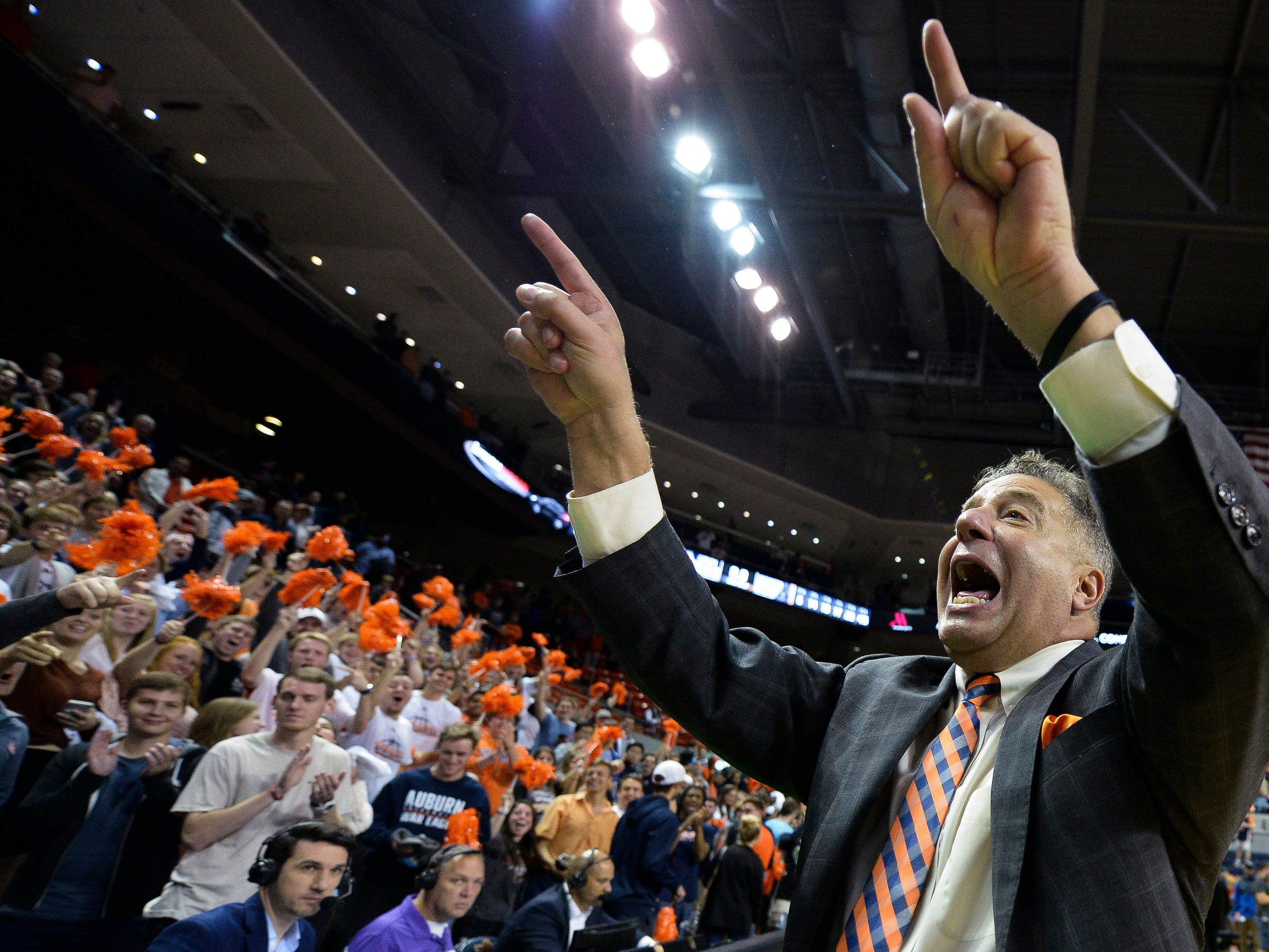 Nov 9, 2018; Auburn, AL, USA; Auburn Tigers head coach Bruce Pearl celebrates with fans in the stands after defeating the Washington Huskies at Auburn Arena. Mandatory Credit: Julie Bennett-USA TODAY Sports