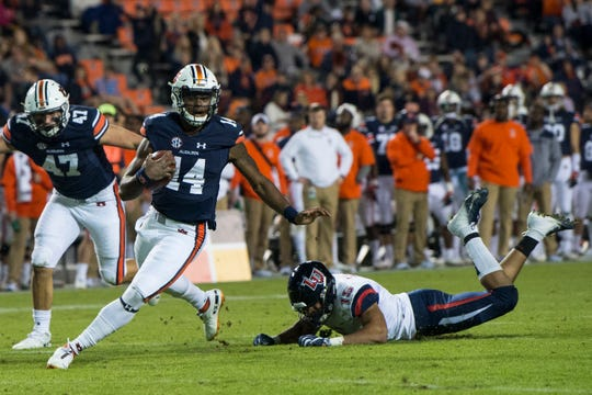 Auburn quarterback Malik Willis (14) runs the ball into the end zone for a touchdown at Jordan-Hare Stadium in Auburn, Ala., on Saturday, Nov.. 17, 2018. Auburn defeated Liberty 53-0.