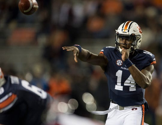 Auburn quarterback Malik Willis (14) throws the ball down field against Liberty at Jordan-Hare Stadium in Auburn, Ala., on Saturday, Nov.. 17, 2018. Auburn defeated Liberty 53-0.