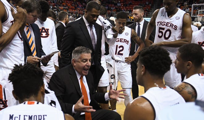 Auburn coach Bruce Pearl talks to players during a game against Mississippi College on Wednesday, Nov. 14, 2018, in Auburn, Ala.