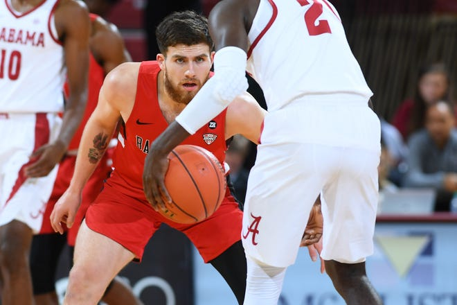 Ball State's Tayler Persons guards against Alabama on day two of men's basketball action in the 2018 Charleston Classic at TD Arena on Friday, November 16, 2018 in Charleston, South Carolina.