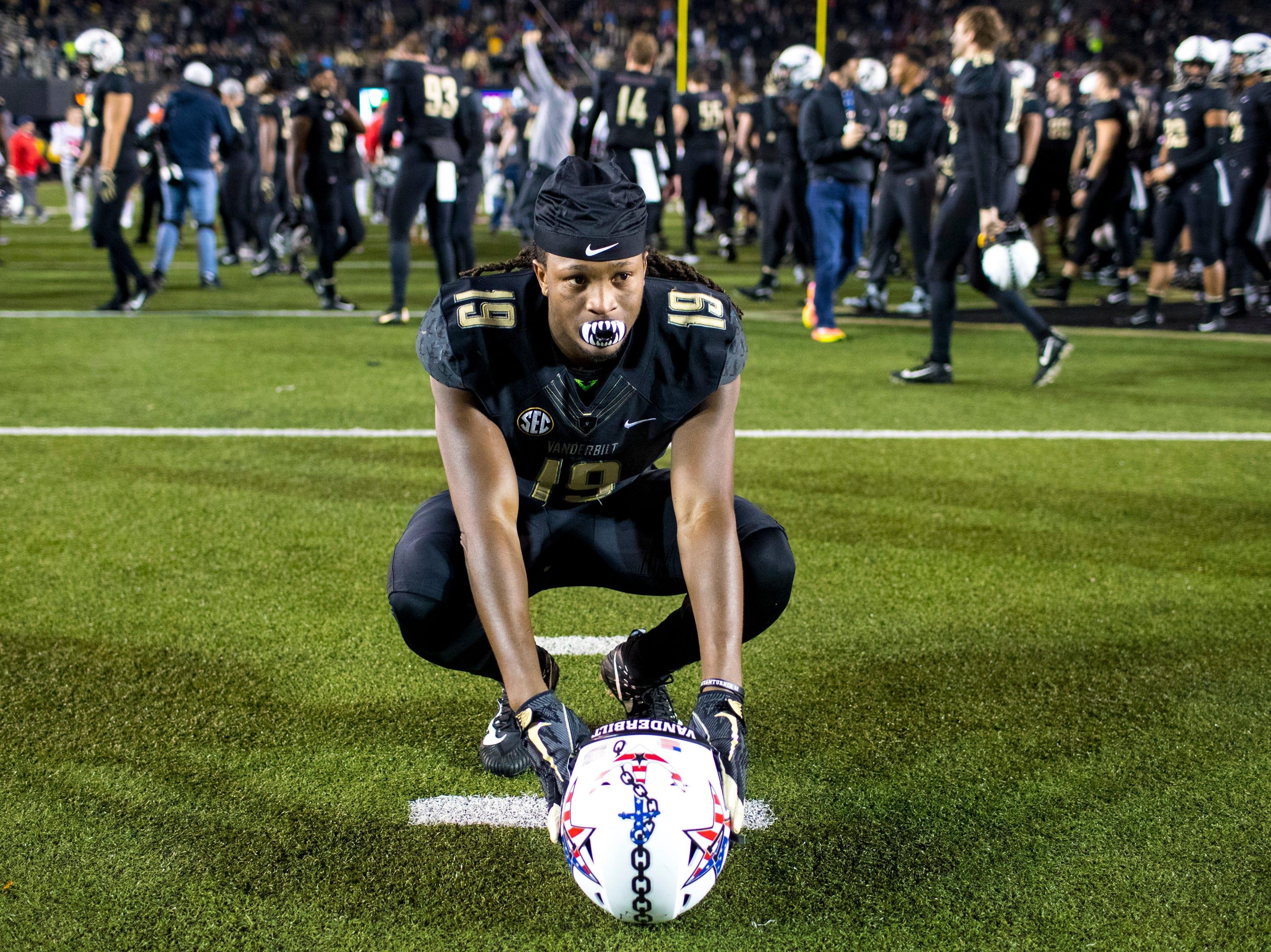 Vanderbilt wide receiver Chris Pierce (19) takes a moment to himself after Vanderbilt's game against Ole Miss at Vanderbilt Stadium in Nashville on Saturday, Nov. 17, 2018.