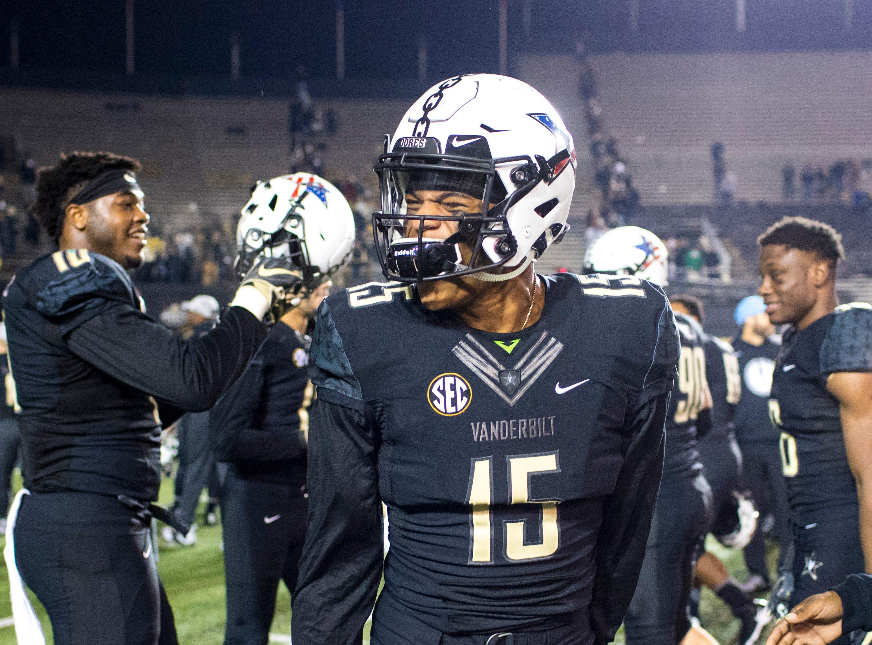 Vanderbilt defensive back Elijah Hamilton (15) celebrates after Vanderbilt's game against Ole Miss at Vanderbilt Stadium in Nashville on Saturday, Nov. 17, 2018.