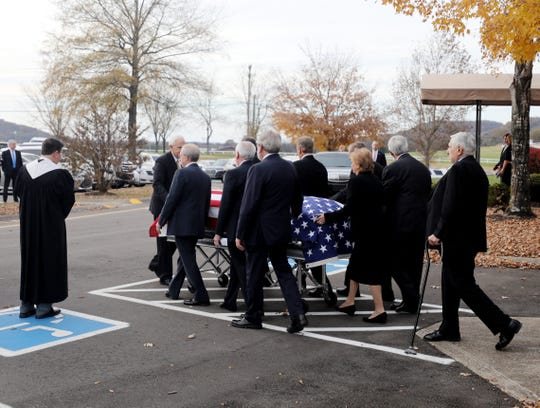 State Representative Charles Sargent's flag draped casket is brought out of First Presbyterian Church in Franklin following his funeral on Sunday, November 18, 2018.