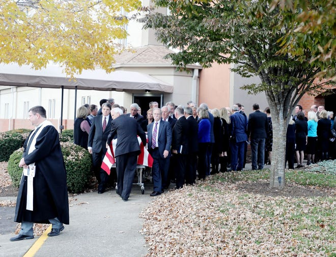 Pallbearers exit First Presbyterian Church with Rep. Charles Sargent's casket after the lawmaker's funeral on Sunday, Nov. 18, 2018.