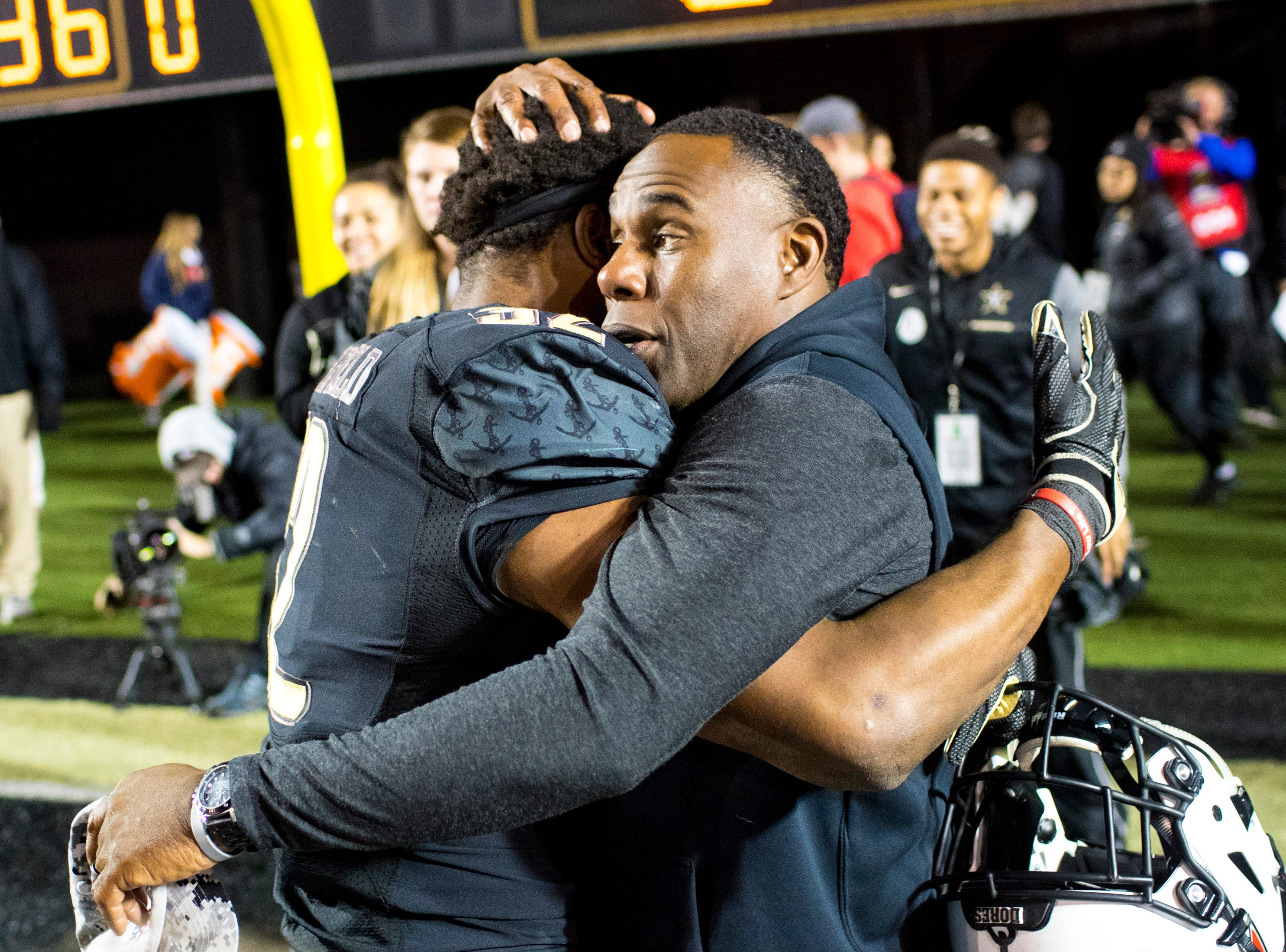 Vanderbilt head coach Derek Mason hugs Vanderbilt running back Jamauri Wakefield (32) after Vanderbilt's game against Ole Miss at Vanderbilt Stadium in Nashville on Saturday, Nov. 17, 2018.