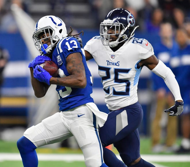 Colts wide receiver T.Y. Hilton (13) pulls in a touchdown pass defended by Titans cornerback Adoree' Jackson (25) in the second quarter at Lucas Oil Stadium Sunday, Nov. 18, 2018, in Indianapolis, Ind.