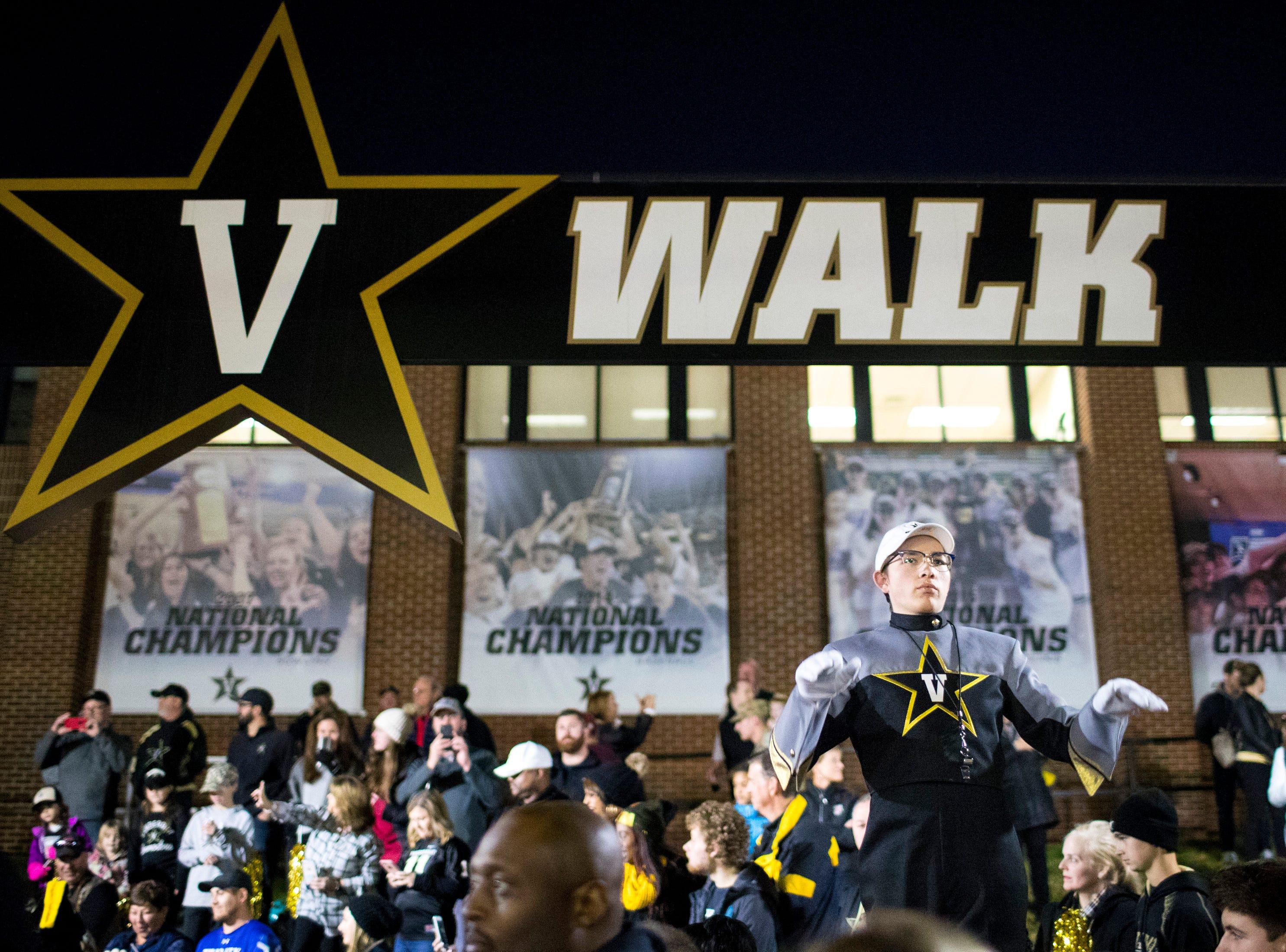 A member of Vanderbilt's marching band directs the band members during the star walk before Vanderbilt's game against Ole Miss outside of Vanderbilt Stadium in Nashville on Saturday, Nov. 17, 2018.