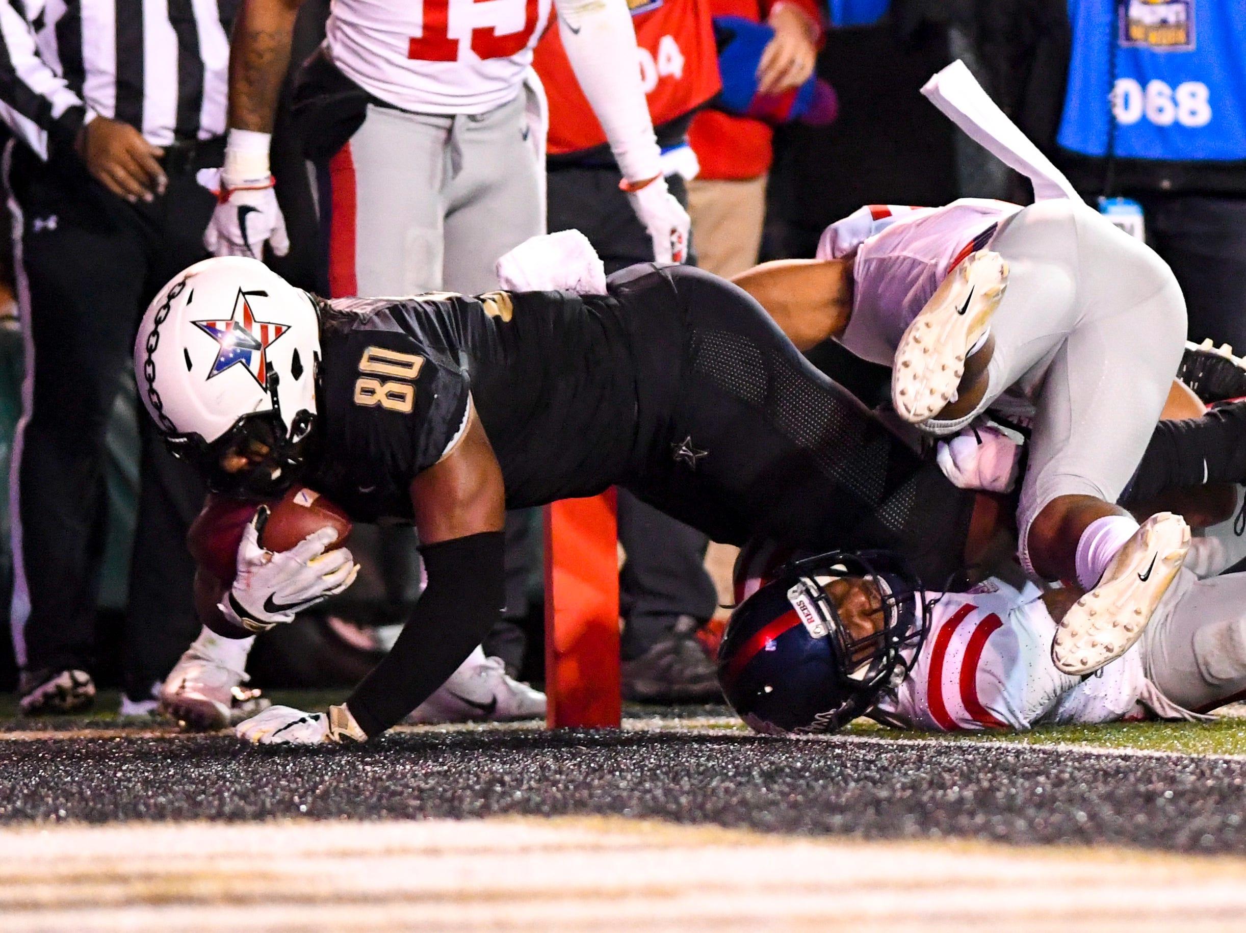 Vanderbilt tight end Jared Pinkney (80) falls into the endzone during Vanderbilt's game against Ole Miss at Vanderbilt Stadium in Nashville on Saturday, Nov. 17, 2018.
