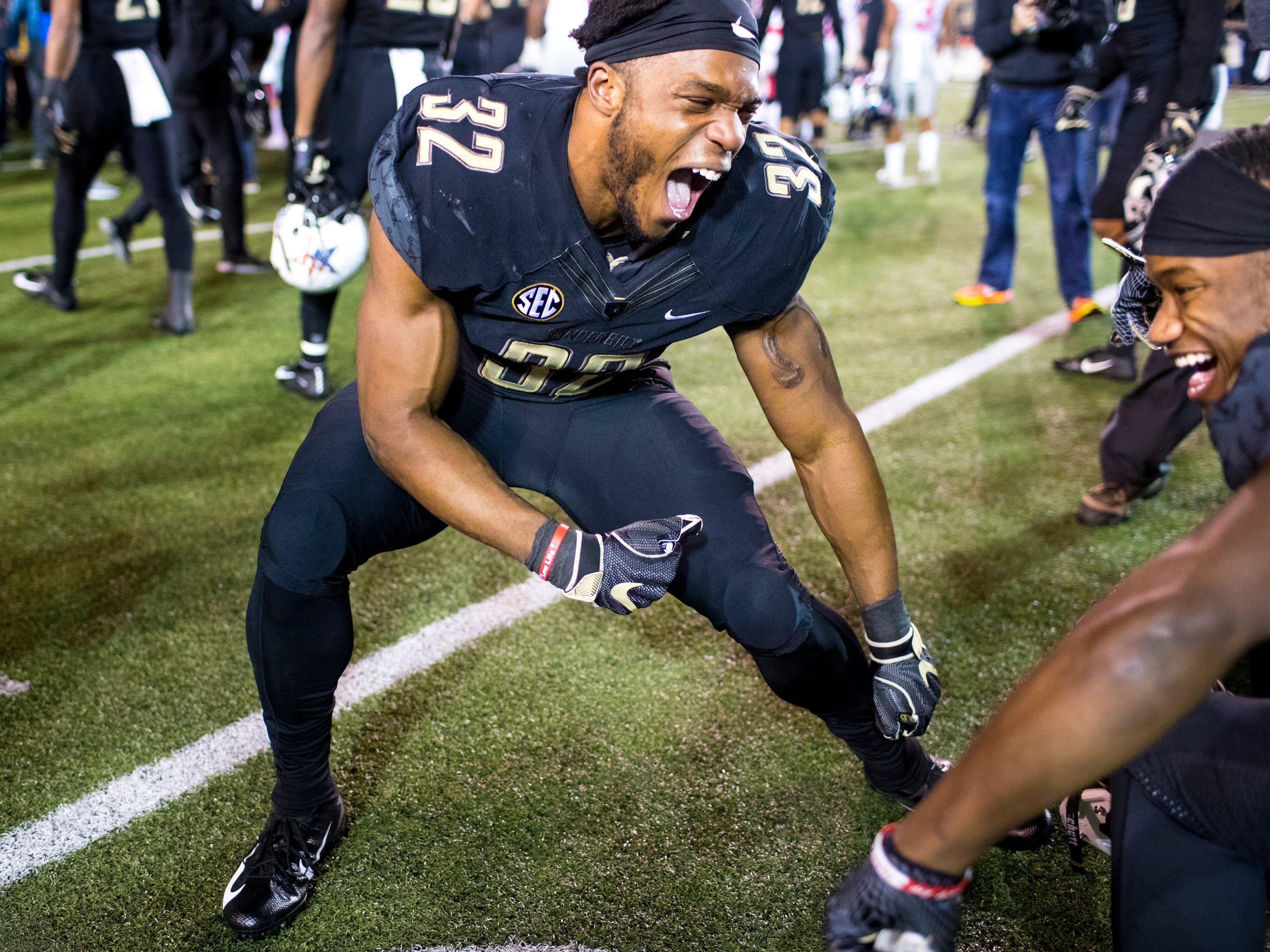 Vanderbilt running back Jamauri Wakefield (32) dances in celebration after Vanderbilt's game against Ole Miss at Vanderbilt Stadium in Nashville on Saturday, Nov. 17, 2018.