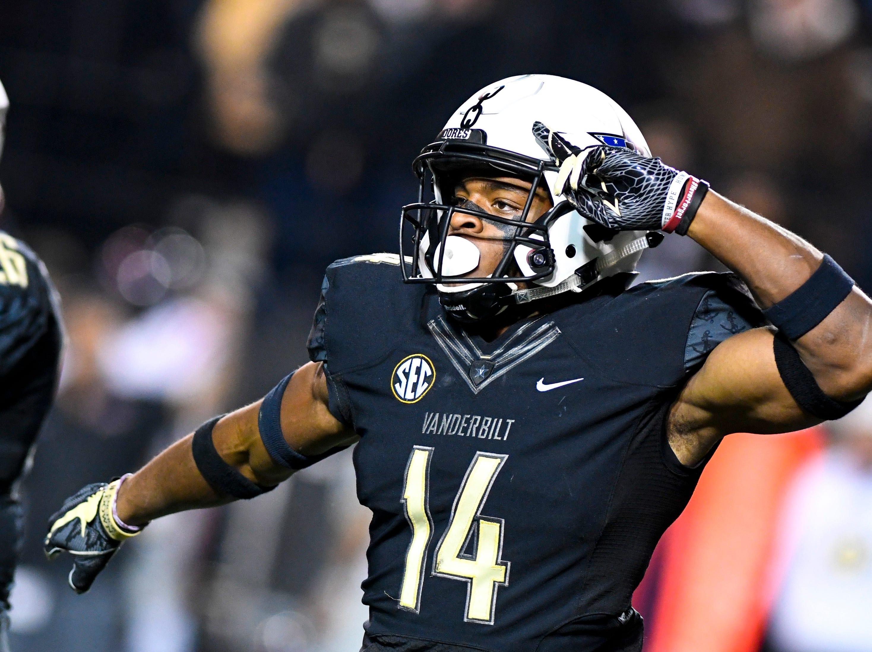 Vanderbilt defensive back Max Worship (14) celebrates after a safety during Vanderbilt's game against Ole Miss at Vanderbilt Stadium in Nashville on Saturday, Nov. 17, 2018.