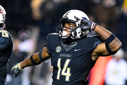 Vanderbilt defensive back Max Worship (14) celebrates after a safety during Vanderbilt's game against Ole Miss at Vanderbilt Stadium in Nashville on Saturday, Nov. 17, 2018.