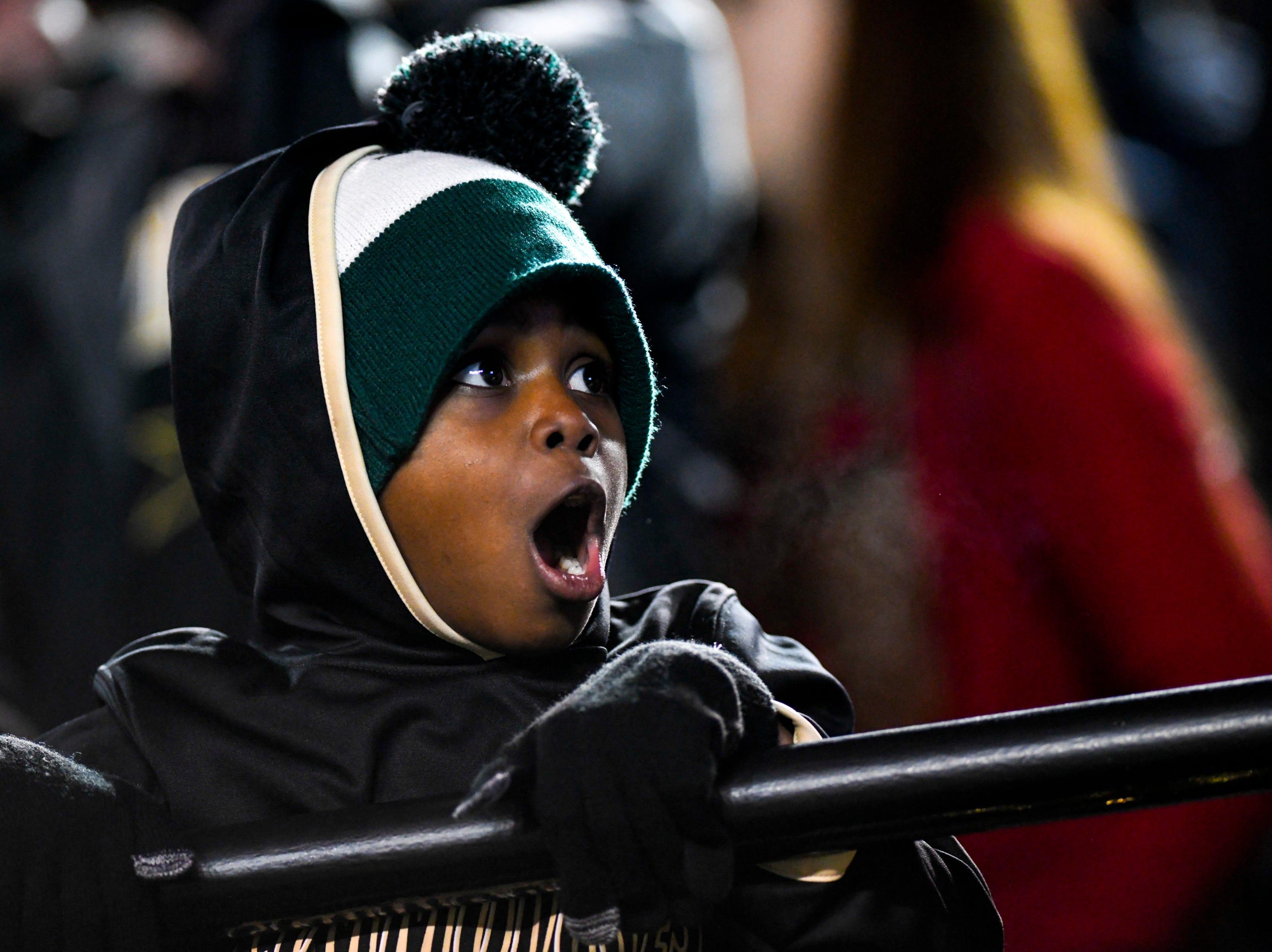 Elijah Oliver, 7, reacts to the play on the field during Vanderbilt's game against Ole Miss at Vanderbilt Stadium in Nashville on Saturday, Nov. 17, 2018.
