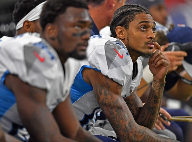 Titans wide receivers Corey Davis, left, and Tajae Sharpe sit on the bench in the second half against the Colts on Sunday.