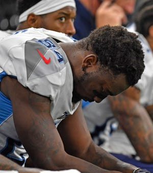 Titans wide receiver Corey Davis hangs his head on the sideline in the second half Sunday.